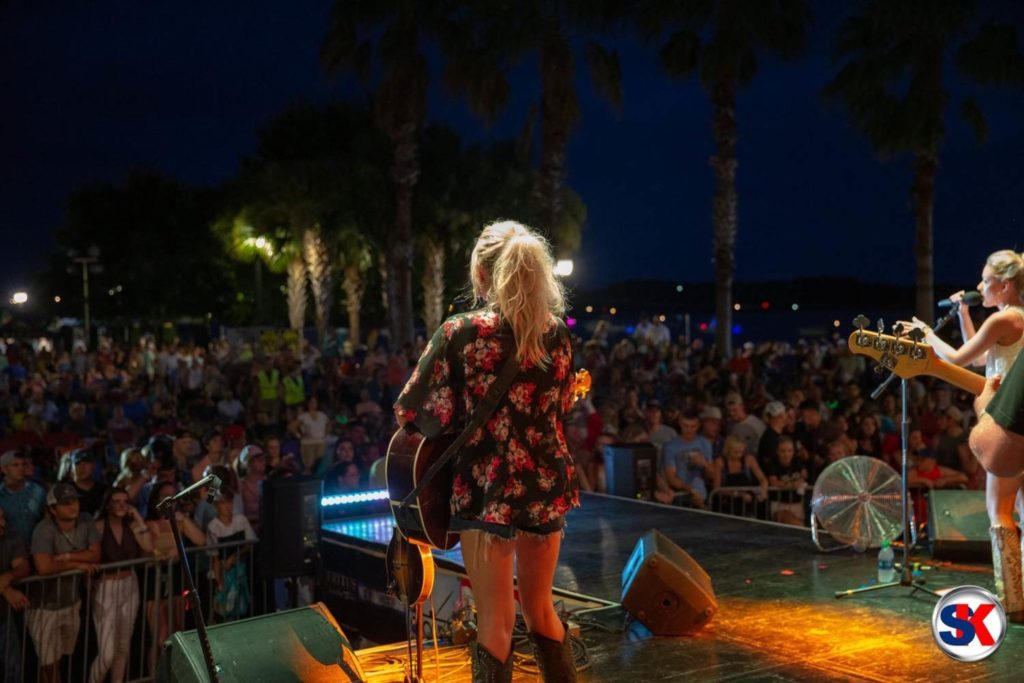 Kristen on stage with Emily Ann Roberts at the Beaufort Water Festival in Beaufort, South Carolina. Photo by SK Productions.