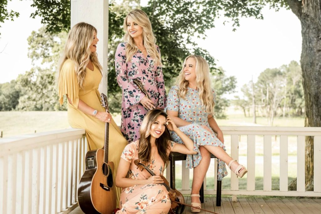Kristen with her band, HighRoad. From left to right Kinsey Rose, Kristen, Lauren Conklin, and Sarah Davidson. Photo by Tiffany Graham, Sunkissed Smiles Photography.