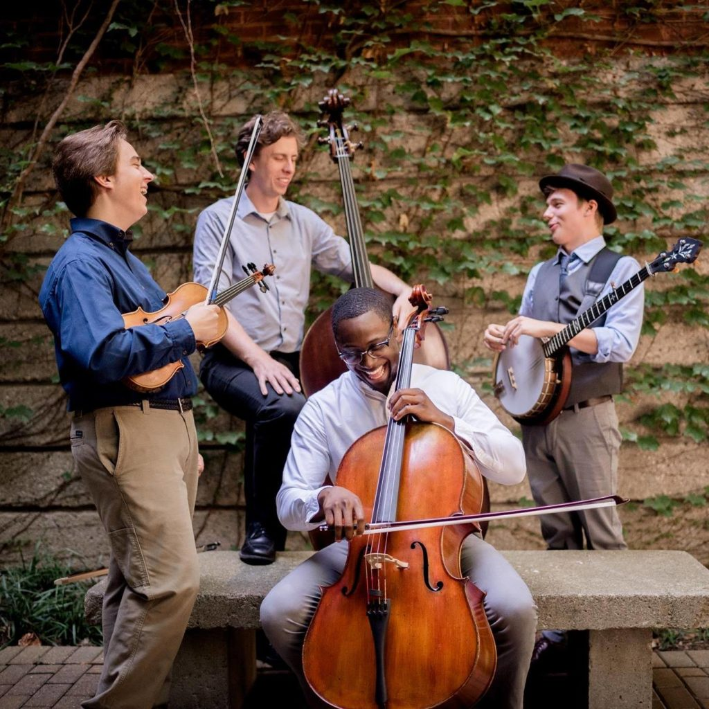 Grant with The Westbound situation. From left to right, Grant, Jacob Warren (bass), Zach Brown (cello), Matthew Davis (banjo). Photo by Beth Flick.