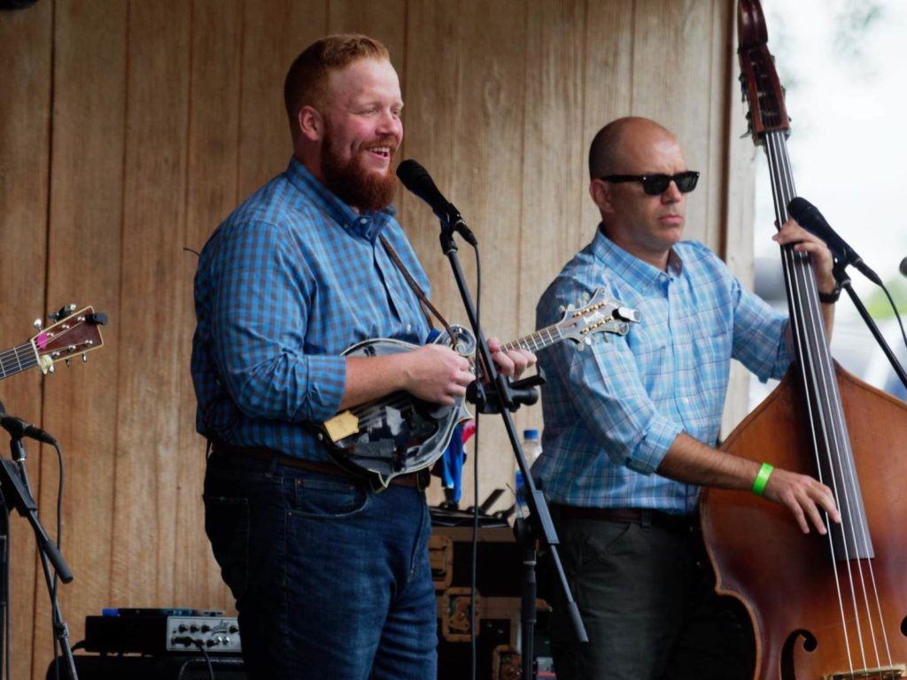 Jesse Smathers performing alongside Barry Reed with Lonesome River Band