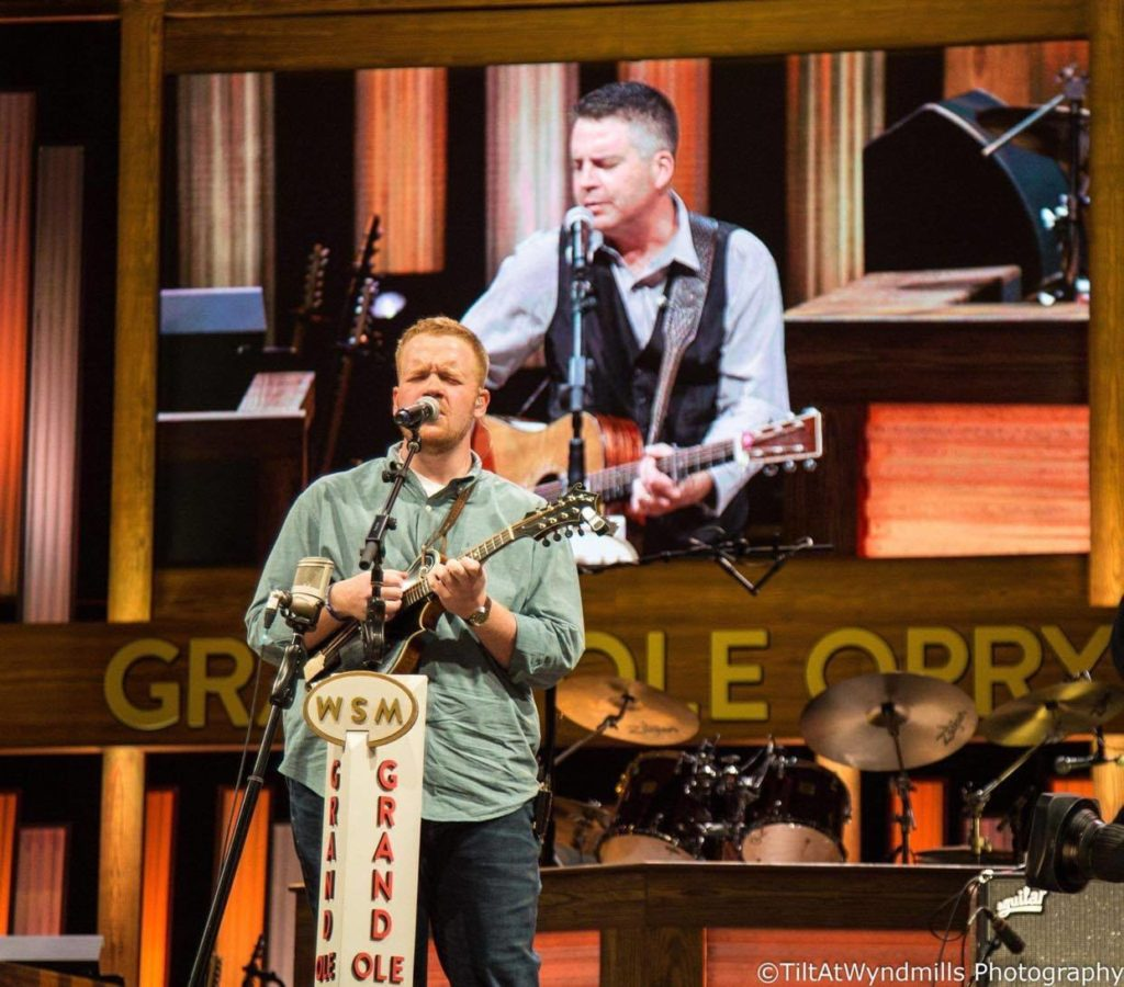 Jesse performing with Lonesome River Band at the Grand Ole Opry. Photo by TiltAtWyndmills photography.
