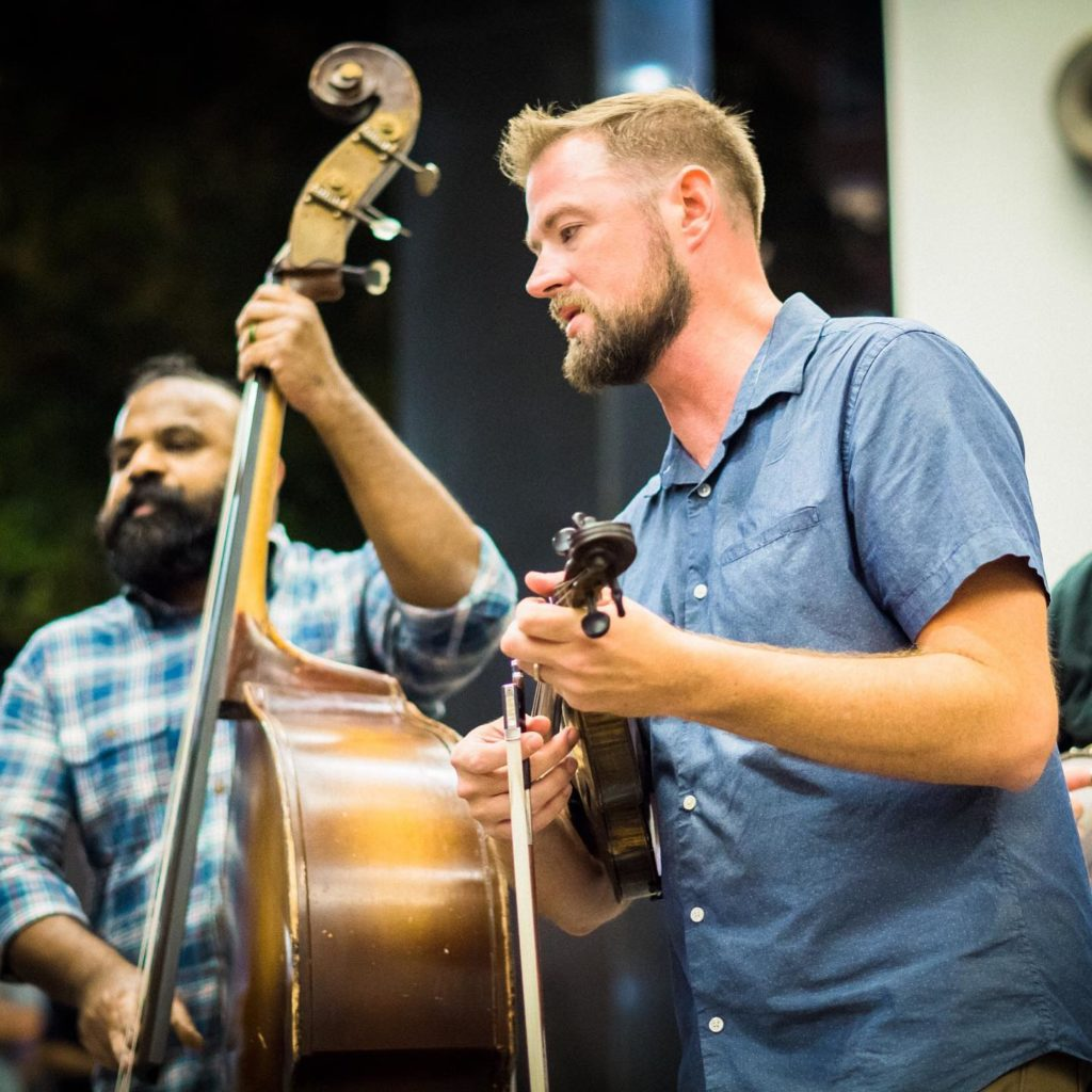 Sav performing alongside Unspoken Tradition bandmate Tim Gardner at the 2019 IBMA World of Bluegrass Convention